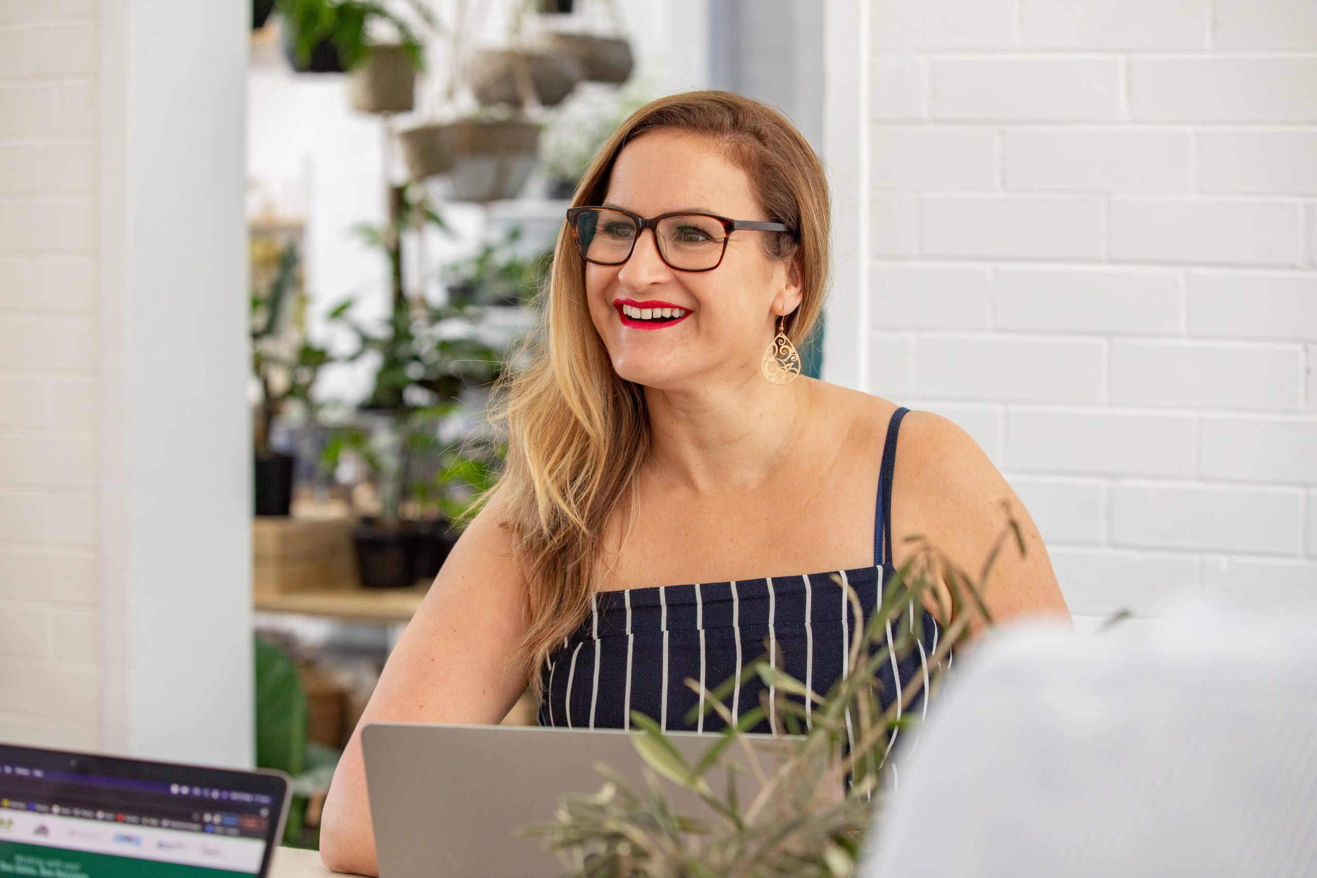 Affordable SEO for Small Businesses - Smiling woman with a laptop