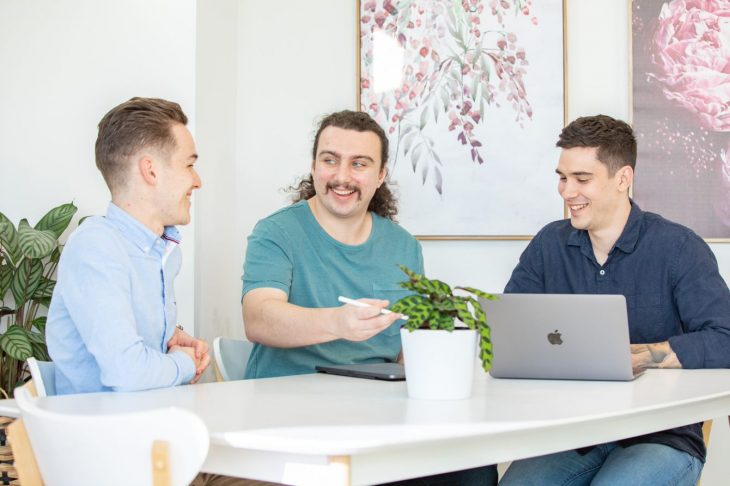 Web Development for small businesses - men sitting at table